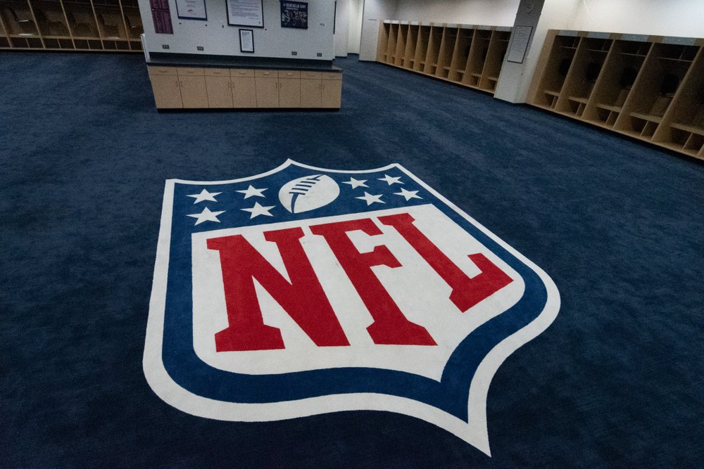 The NFL logo is displayed in the visitors locker room