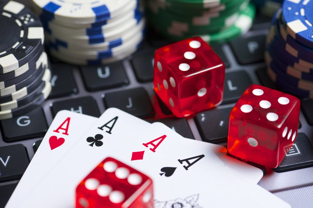 cards dice and casino chips on keyboard