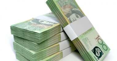 A stack of bundled one hundred australian dollar notes on an isolated background