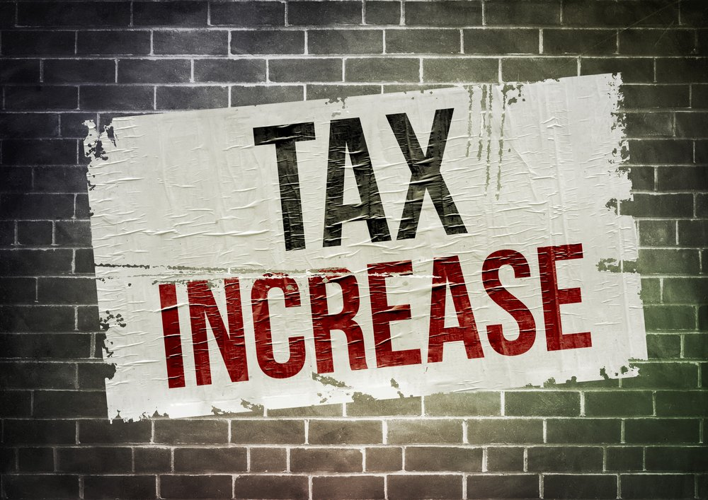 tax increase written in poster on wall